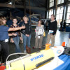 Amy Kukulya (second from left) and Al Pluddemann (right), both of Woods Hole Oceanographic Institution, discuss REMUS Autonomous Underwater Vehicle operations with visitors at an OOI community event at The New Bedford Whaling Museum. (Credit: Jayne Doucette, Woods Hole Oceanographic Institution)