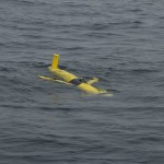 The glider moments after it was deployed from the R/V Pacific Storm. (Photo Credit: Craig Hayslip, OSU)