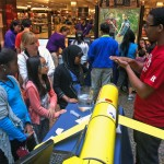 Brandon Rogers from Rutgers answers questions from students about how a piston is used to change the buoyancy of a glider. (Photo Credit: Mike Crowley)