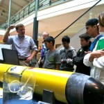 Mike Crowley, OOI EPE, explains glider operation to a school group and their teacher who visited the career fair. (Photo credit: Leslie Smith)