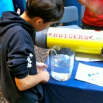 Students were able to get their hands wet and learn with a buoyancy experiment. (Photo credit: Leslie Smith)