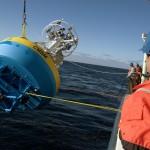 Deployment of the Coastal Surface Mooring surface buoy. (Photo Credit John Lund, Woods Hole Oceanographic Institution)