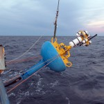 Deployment of the Upstream Inshore Profiler Mooring surface buoy. (Photo Credit John Lund, Woods Hole Oceanographic Institution)
