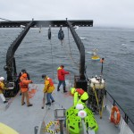 The science party on the R/V Oceanus deploying the Endurance Array Oregon Inshore Surface Mooring in 25m of water off the coast of Newport, OR. (Photo Credit: Tom Kearney, Oregon State University)