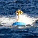 The surface buoy of a OOI Coastal Profiler mooring is designed to be completely submersible. In part this is to allow buoy components to survive the deployment transition - the short period while the anchor is dropping to the bottom and the buoy is being pulled rapidly towards the anchor. The buoy may submerge for a short period during this transition. (Photo Credit: Aidan Alai, WHOI/CGSN)