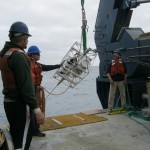 Deployment of the load cage with the controller and acoustic modem during the Hybrid Profiler Mooring deployment operations. (Photo Credit: OOI Coastal Global Scale Nodes program Argentine Basin deployment team)