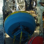 Deck view from an upper deck at the beginning of the Argentine Basin cruise: the Surface Mooring on the starboard side and the two glass spheres for the Global Profiler Mooring, aft of it. (Photo Credit: OOI Coastal Global Scale Nodes program Argentine Basin deployment team)