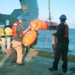Flanking Mooring B release float deployment. This float sits at approximately 500m in the water column and, along with the bottom release, can allow the recovery team to pick up the mooring in two parts if needed. (Photo Credit: OOI Coastal Global Scale Nodes program Argentine Basin deployment team)