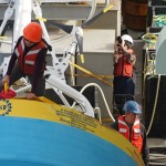 Meghan Donohue, WHOI mooring technician, making preparations to deploy the Argentine Basin Surface Mooring buoy over the starboard side with the crane. (Photo Credit: OOI Coastal Global Scale Nodes program Argentine Basin deployment team)