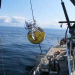 The Oregon shelf surface mooring is lowered to the water using the R/V Oceanus ship's crane. (Photo Credit: OOI Endurance Array Program, OSU)