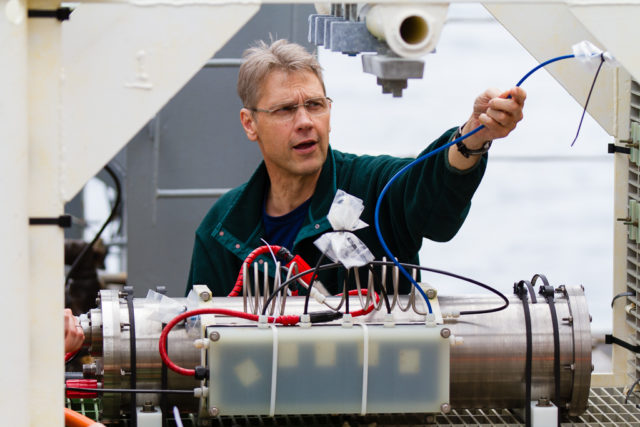 UW Scientist Orest Kawka preparing the mass spectrometer (MASSP) instrument for deployment in 2014. Photo by Ed McNichol.