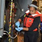 Sampling fluids from the Deep - University of Washington undergraduate student Kearstin Williams, samples seawater for ship- and shore-based analyses to verify instruments on the moorings. Photo Credit: Mitch Elend, University of Washington, V15.