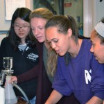 Learning How to Measure Oxygen In the Ocean - University of Washington undergraduate students learn how to make measurements of dissolved oxygen in seawater taken at depths of 1000 m beneath the ocean's surface during Leg 1. (Photo Credit: Debbie Kelley, University of Washington)