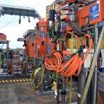 Profiler Science Pods Waiting to be Installed - A line of shallow winched profilers and instrumented platform interface assemblies await installation on 2-legged Shallow Profiler Moorings that provide real-time data on chemical, biological, and physical properties of ocean waters off the coast of Oregon. Photo Credit. Deb Kelley, University of Washington, V15.