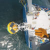 The Ocean Observatories Initiative is moving full speed ahead at Woods Hole Oceanographic Institution.  This unprecedented ocean science project is streaming a wealth of marine data straight from the ocean to the World Wide Web, making it free for anyone to use.  In the image above, an OOI coastal surface buoy is recovered from the ocean and hoisted onto the fantail of the research vessel Neil Armstrong.  Photo Credit: Paul Matthias, WHOI