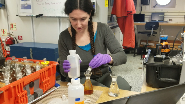 Hilary Palevsky preparing to measure the dissolved oxygen concentration of a seawater sample in the main laboratory of the R/V Neil Armstrong. Photo credit: Emma Jackman