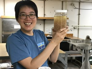 Checking a jar of samples full of krill and other creatures. Credit: Romina Centurion/UW