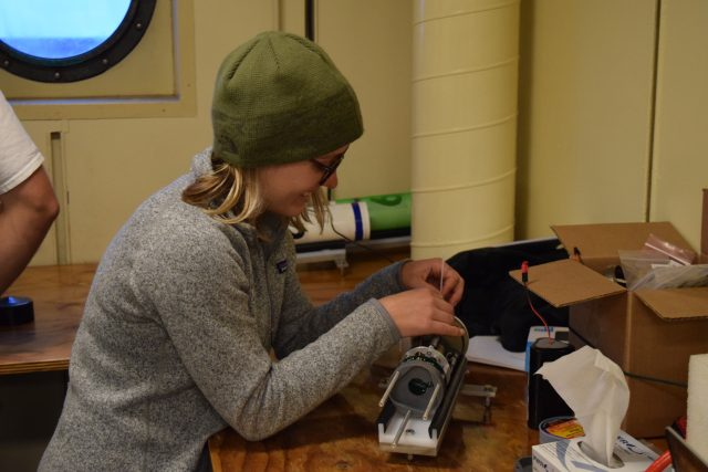 Preparing a mini bottom pressure recorder (BPR) for deployment on an Axial Cruise. Photo Credit: Haley Cabaniss