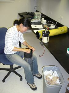 Maintenance of acoustic instrument during her MS program in University of Maine (Darling Marine Center). Credit: Mei Sato