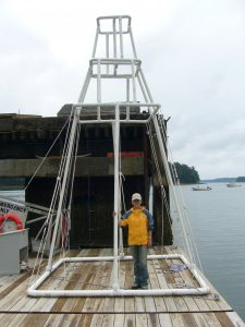 Frame to deploy hydroacoustics underwater, made of PVC pipes, at the dock of Darling Marine Center. Credit: Mei Sato